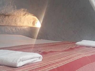la cama en Paraiso desde una esquina